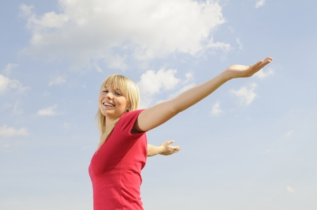 happy young woman spreads her arms