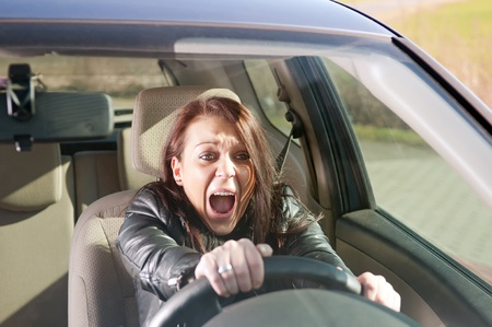 afraid young woman screaming in the car