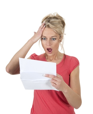 surprised woman gets letter with bad news