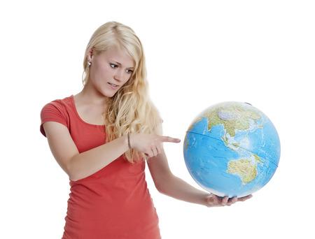 beautiful young blond woman showing globe