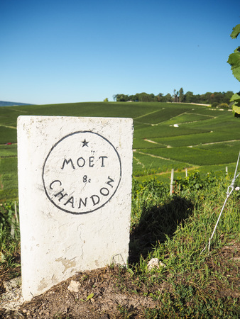 Champagne - Ardenne, France - AUgust 2017: Moët & Chandon old stone roadside sign next to the vineyards in Hautvillers close to Epernay