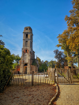 September 2018 - Hainaut, Belgium: the remains of the old chruch tower of the Abbey of Cambron, now the bird tower of the zoo Pairi Daiza