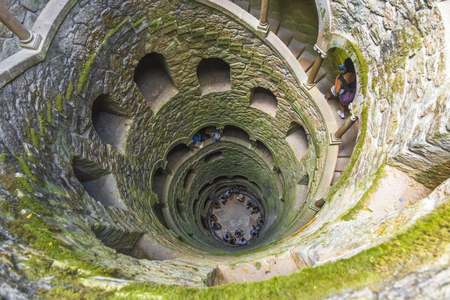 Looking down into the 'Initiation Well' into the 'Quinta da Regaleira' park in Sintra