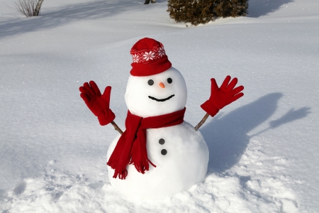 Photo for Snowman in red on a cold winter morning. - Royalty Free Image