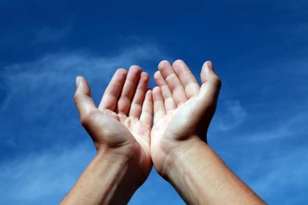 Hands offering towards the sky