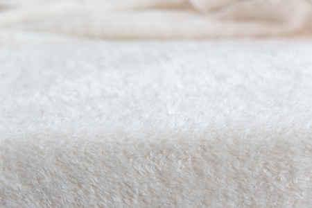 Foto de White delicate soft background of plush fabric. Texture of beige soft fleecy blancet - Imagen libre de derechos