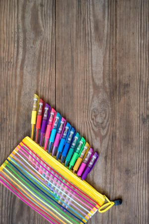 Photo for Set of multicolored gel pens on wooden background. School concept. Copy space. - Royalty Free Image