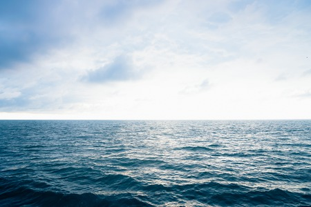 Photo pour View from cabin balconies at the rough seas and waves off the side of cruise ship. Seascape picture. The sky with clouds, not big waves on sea surface. Excitement at sea - image libre de droit