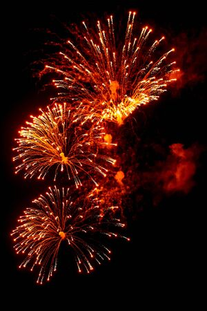Photo pour Close-up red and gold festive fireworks on a black background. Abstract holiday background  - image libre de droit