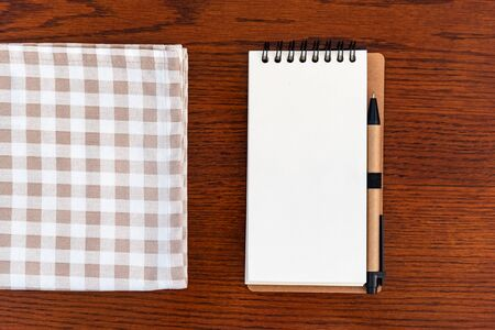 Photo for A Kitchen towel or napkin over the wooden table. Close up. - Royalty Free Image