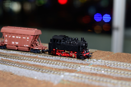 Toy steam locomotive train model on the railway