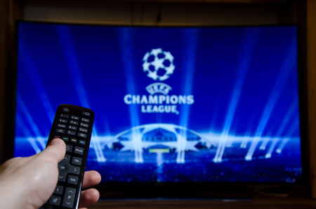 Soest, Germany - January 14, 2018: Man watching UEFA Champions League on TV. The UEFA Champions League is an annual continental club football competition.