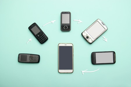 Photo pour evolution of cell phones. Technology development telephone and pda concept. Vintage and new phones. Top view. Telephone communication progress, mobile classic device . charts, arrows, text around - image libre de droit