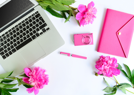 Foto de Laptop, peonies and pink working objects on white background. Flat lay of working place - Imagen libre de derechos