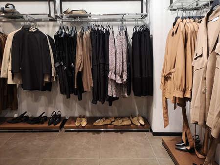 Foto de Row of clothes garment spring, autumn and winter woman fashion collection - Imagen libre de derechos