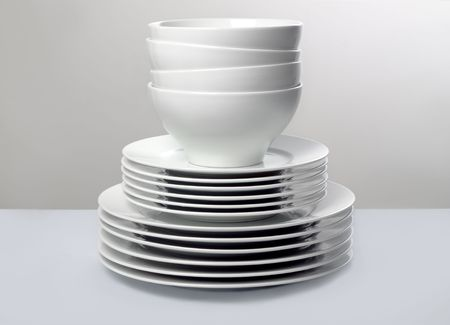 Commercial White Dishes Stacked with Neutral Background