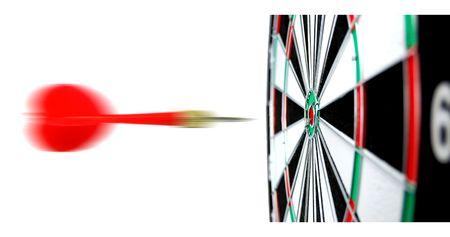Dartboard with flight of dart on the bullseye