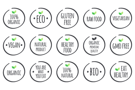 Illustration for grey symbols with green leaves on white. 100% Organic, Eco, Gluten Free, Raw Food, Vegetarian, Vegan, Natural Product, Healthy Food, Premium Quality, Gmo Free, You are what you eat, Bio, Eat Healthy. - Royalty Free Image