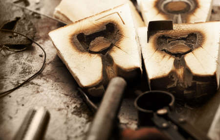 Old wooden jewelry molds for casting precious metals in a goldsmith workshop