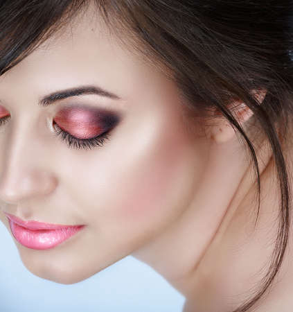 Beautiful brunette woman with pink smoky eyes eyeshadow and soft smile � natural make-up with good skin texture