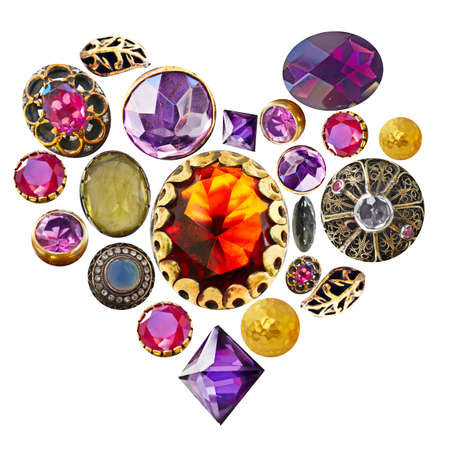 gemstones in gold and bronze isolated in a heart shape on white background.