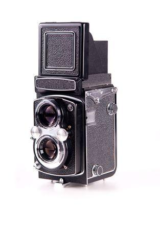 Antique medium format film mechanical camera isolated on white