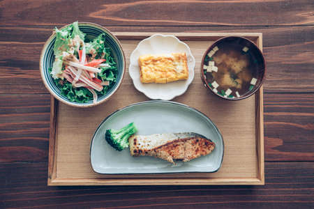 Photo for Japanese set lunch, fried salmon fish with miso soup (tonjiru) . - Royalty Free Image