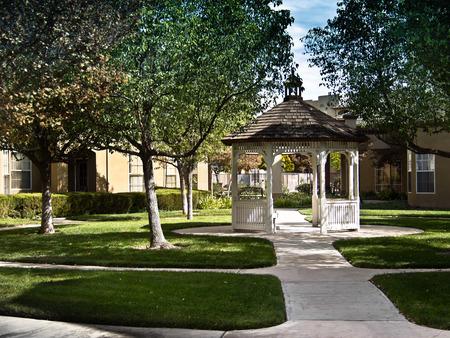 Pathways lead to a gazebo in a courtyard.