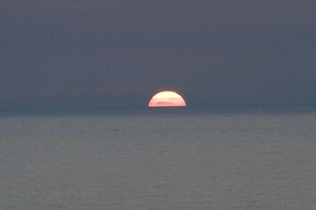 Photo pour Sunset  on a beach  - image libre de droit
