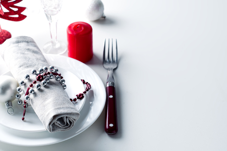 Photo pour Christmas table setting in red with candles in white background - image libre de droit