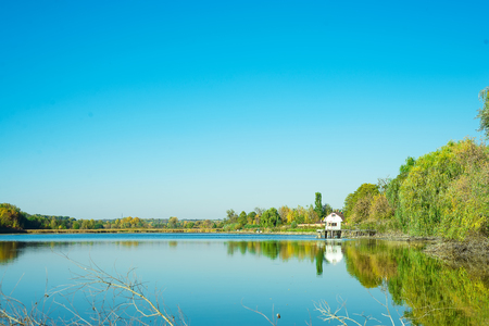 Photo pour Amazing landscape of lake with clear green water and Perfect blue sky. Ukraine - image libre de droit