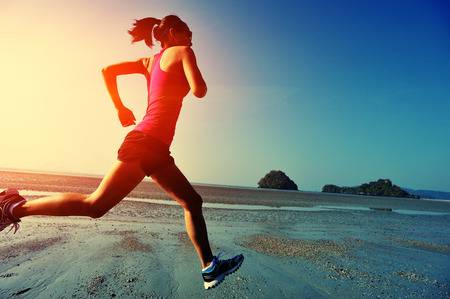 Photo pour young healthy lifestyle woman running at sunrise beach - image libre de droit
