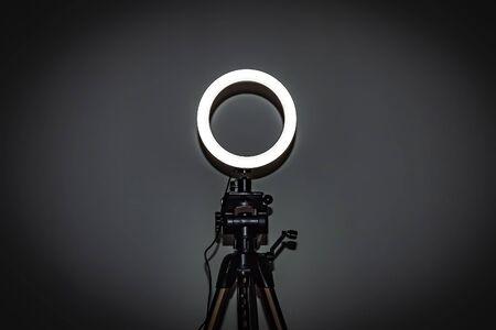 Foto de LED ring lamp with adjustable brightness for a studio camera, photo phone, video lamp with tripods - Imagen libre de derechos