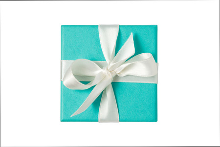Photo for Top view of turquoise isolated gift box with white ribbon on white background - Royalty Free Image