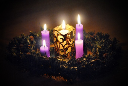 Advent wreath candles, three purple and one pink, light the long, long four week wait for Christmas, the birth of Christ the light of the world.