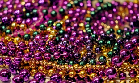 Background of Mardi Gras beads with shallow DOF