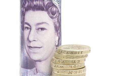 british pound coins with a twenty pound note