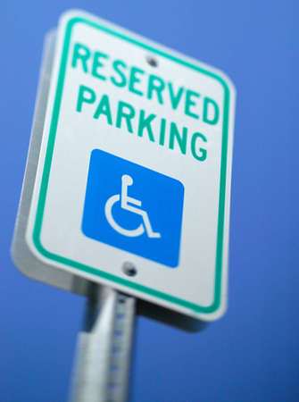 A handicap reserved parking sign for those who are physically disabled.