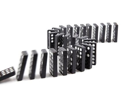 domino effect, black wooden domino line curve