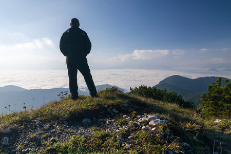 Hiker on a mountain top above the clouds - Choc mountains - Slovakia, Europe