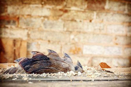 Photo pour Retro stylized old circular saw in carpenter's shop, space for text. - image libre de droit