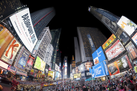New York, USA - August 18, 2015: Fisheye lens photo of Times Squares crowded with tourists at night with Broadway Theaters and animated LED signs.