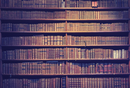 Foto de Vintage toned old books on wooden shelves, wisdom concept background. - Imagen libre de derechos