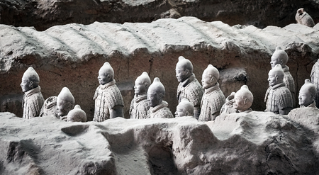 Xian, China - October 4, 2017: Terracotta Army warriors. Three pits contain more than 8000 soldiers, 130 chariots with 520 horses and 150 cavalry horses. No two figures are exactly alike.