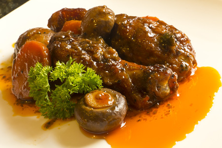 French cuisine, Coq Au Vin, crimini mushrooms, carrots, with wine sauce