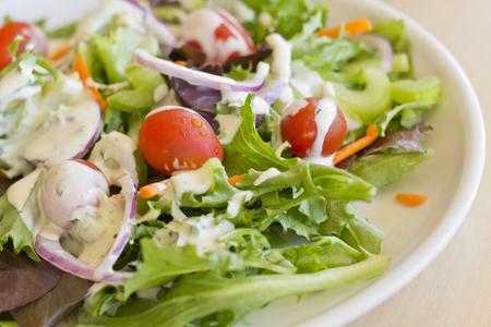 Fresh organic garden salad with creamy ranch dressing