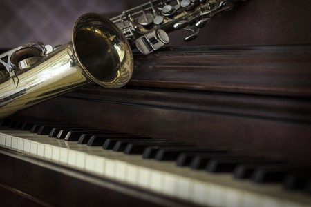 Old and worn Jazz saxophone and piano musical background