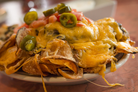 Loaded potato nachos with melted cheddar cheese