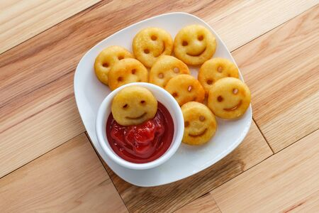 Photo for Happy French fried potato smiley faces with ketchup - Royalty Free Image