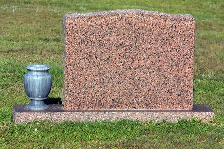 Blank granite tombstone with marble vase